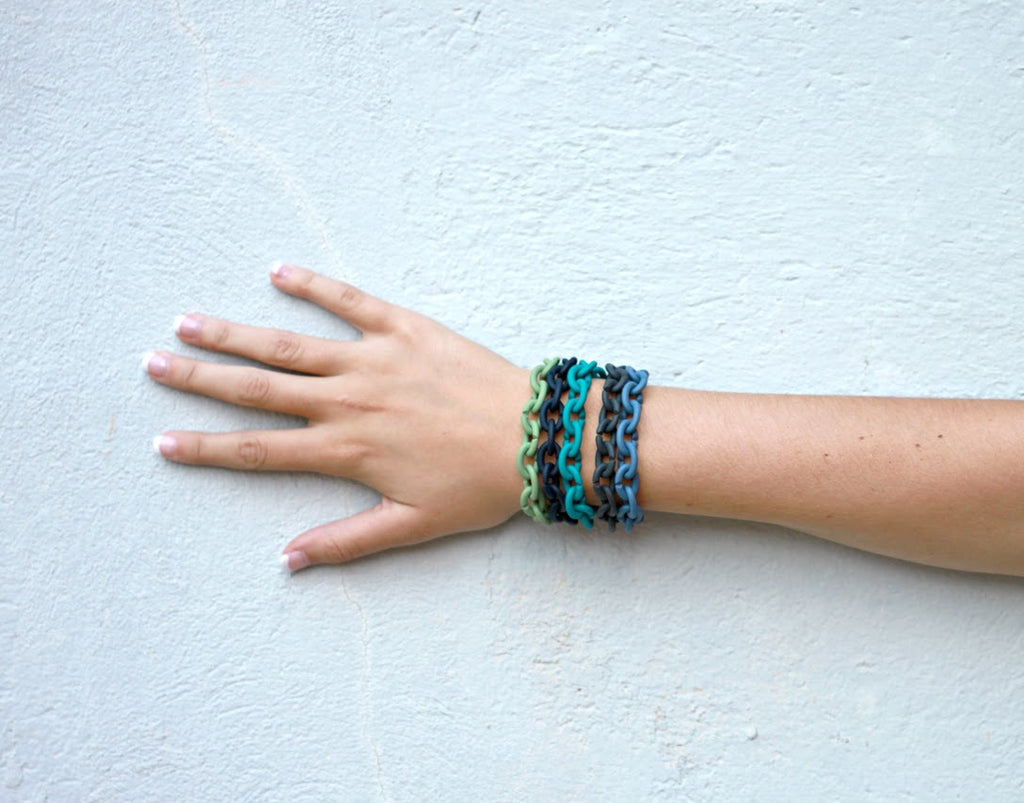 Am I Blue? An arm full of X Jewelry Bracelets in Navy, Deep Petrol, Denim Blue, Turquoise and Pale Green