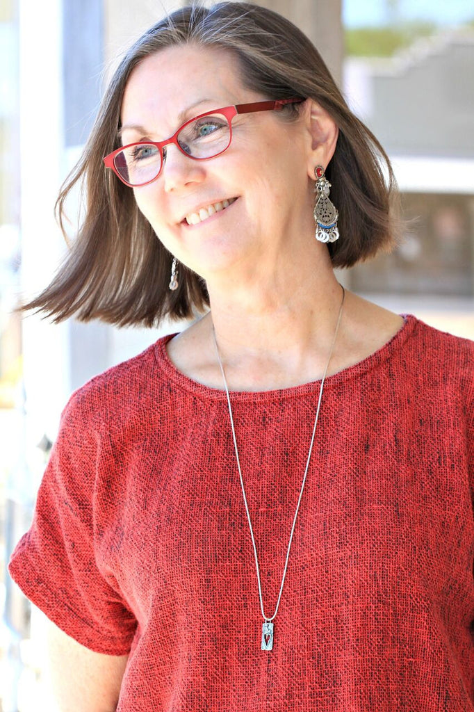 Denise styling the Silver Cross Bangle by Visible Faith Jewelry with Ayala Bar Earrings and a necklace by Visible Faith Jewelry as well. All available at Coco and Duckie. #CocoandDuckie #LetInTheLovely #LOTD #OOTD #Style #Fashion #Linen #Red #Jewelry #Accessories