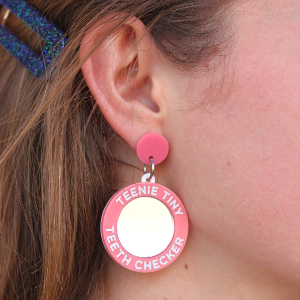 woman wearing things by bean teenie tiny teeth checker earrings in pink - cocoandduckie.com