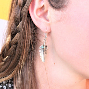 woman wearing sterling silver and turquoise feather earrings - coco and duckie