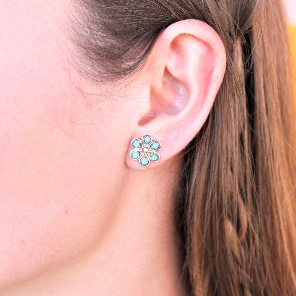 woman wearing turqoise flower and sterling silver earrings - coco and duckie