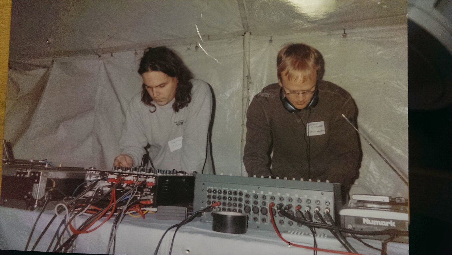 image is a photo of a vintage printed-out photo showing Stephen and another musician very focused on making some jams