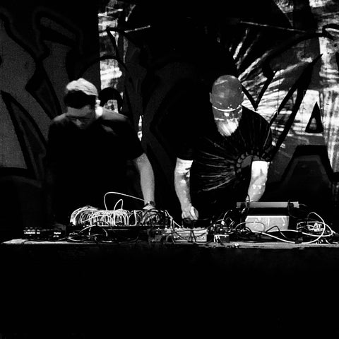 Black and white photo of Tim and Mike performing