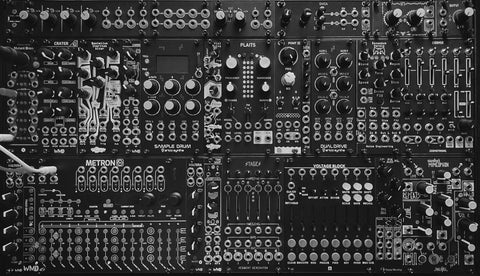 Black and white photo of a mid-sized Eurorack system.