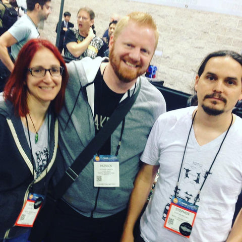 Kris, Patrick, and Stephen stand next to each other at NAMM.