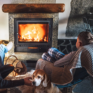 relaxing with the family by a fireplace from hearth and home
