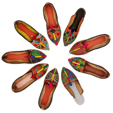 Load image into Gallery viewer, Old Fashioned Online Nine very colourful hand crafted embroidered leather house shoes that are arranged in a circle