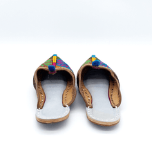 Load image into Gallery viewer, Old Fashioned Online Indian Jutti bohemian slippers with blue, green pink and gold floral embroidery, blue pompoms and cushioned footbed back view