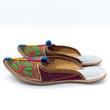 Load image into Gallery viewer, Old Fashioned Online Indian Jutti bohemian slippers with blue, green pink and gold floral embroidery, blue pompoms and cushioned footbed side view 1