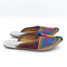 Load image into Gallery viewer, Old Fashioned Online Indian Jutti bohemian slippers with blue, green pink and gold floral embroidery, blue pompoms and cushioned footbed side view 2