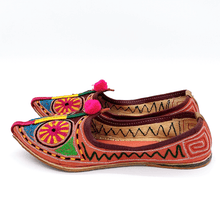 Load image into Gallery viewer, Old Fashioned Online Indian bohemian leather slippers with pink and gold fortune embroidery with pompoms and cushioned footbed side view 1