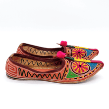 Load image into Gallery viewer, Old Fashioned Online Indian bohemian leather slippers with pink and gold fortune embroidery with pompoms and cushioned footbed side view 2