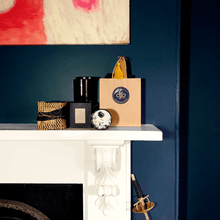 Load image into Gallery viewer, A picture of gifts and candles on a fire place mantle in a dark blue room