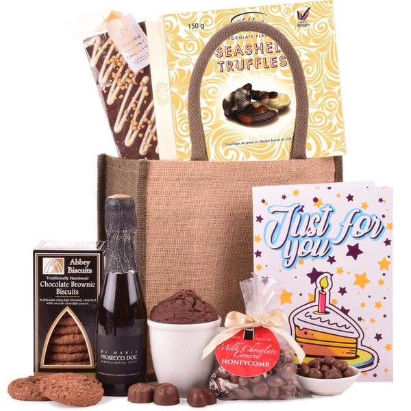 Birthday Gift Bag from Thornton & France including chocolate bar, chocolate truffles, chocolate brownies, chocolate cake and most importantly Prosecco