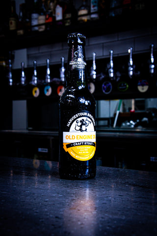 An ice cold bottle of Harviestoun Brewery Bitter & Twisted Golden Ale, sat on top of a Bar