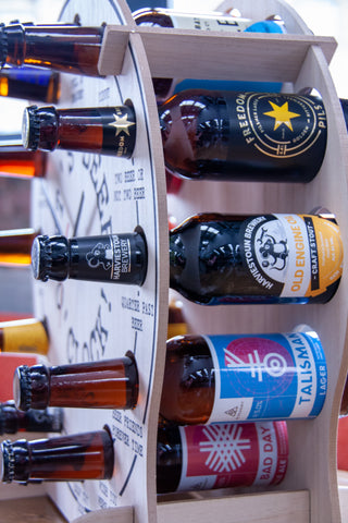 The fully stocked Beer O'Clock from a side on angle, fully stocked with drinks from Harviestoun Brewery, Alechemy Brewing Ltd, Freedom Brewery and Cold Bath Brewing Co.