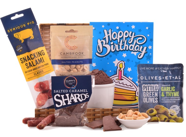 Combining both savoury and sweet treats, this blue gift bag is the perfect birthday gift.