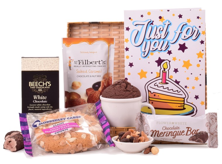 Combining an array of sweet treats, this white gift bag is the perfect birthday gift.