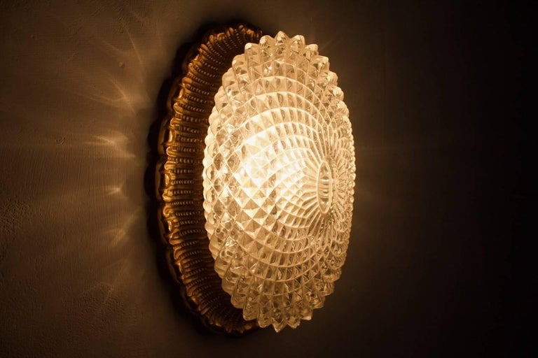 One of Two Oval Wall Sconces with Textured Glass and Gilded Metal by Limburg