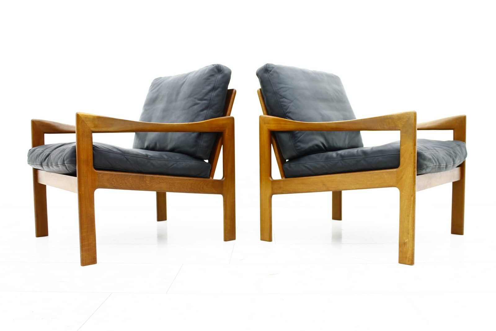 A Pair Illum Wikkelso Lounge Chairs, Teak & Leather