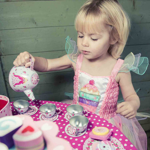 Pouring from a pretend tea pot helps develop fine motor skills.