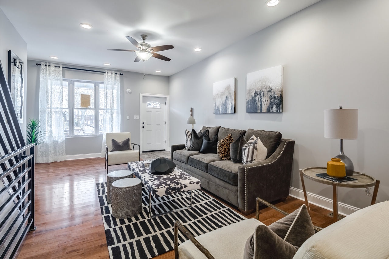 Gray living room with suede sofa and black and white rug