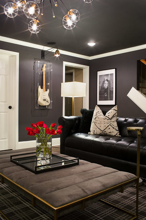 forbes and master designed music room with guitar on wall and light fixture