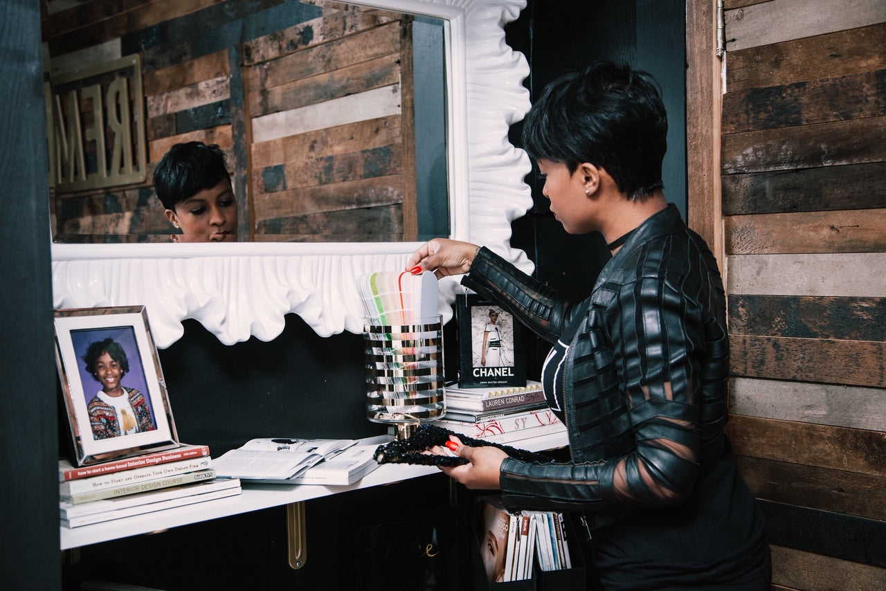 Remix Living's Dominique Calhoun in her office looking at samples