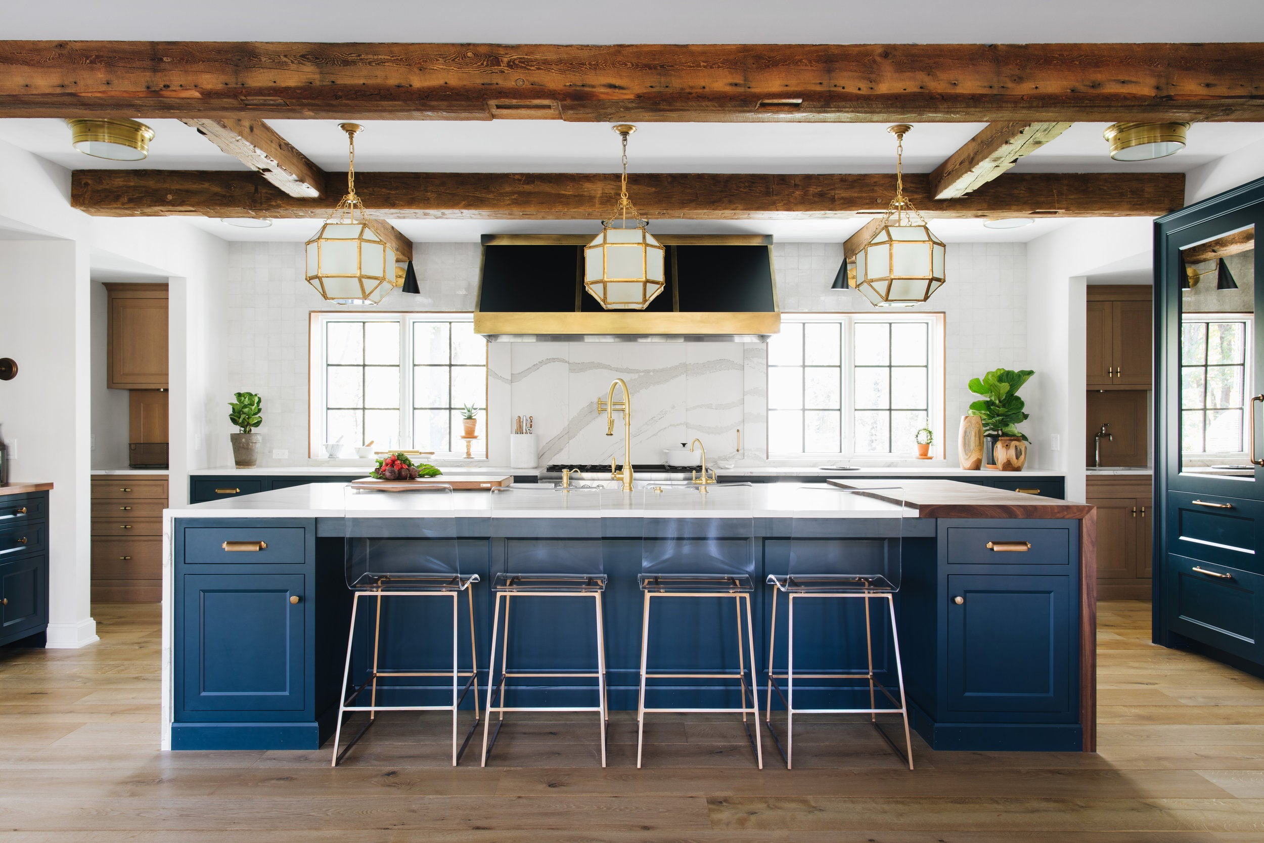 Blue island and white marble counter tops in Jean Stoffer's Lakeside house kitchen