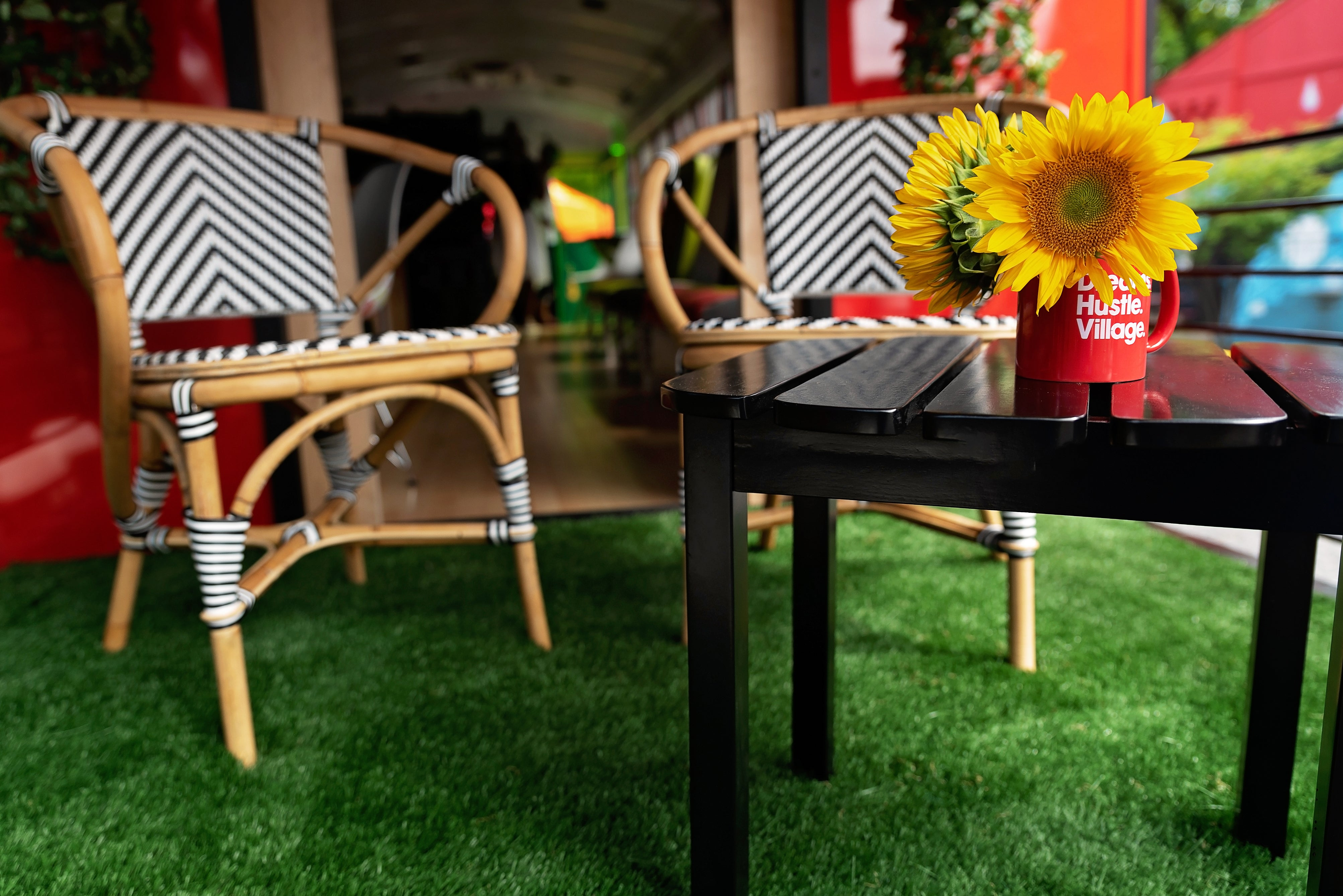 Kiyonda Powell upcycled a bus and creating a green patio on the back with chairs and flowers