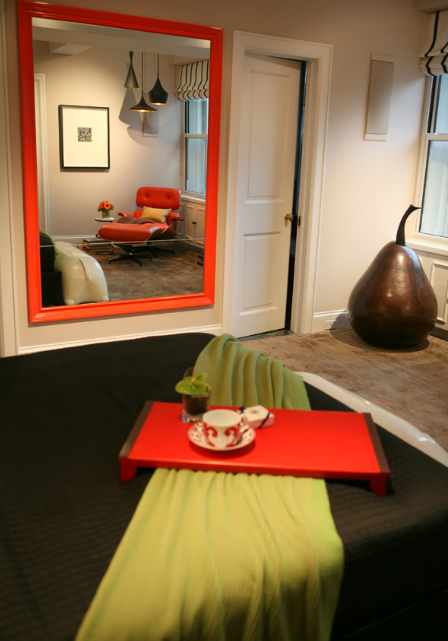 Tyler Wisler's Playful Master Bedroom with red mirror and tray and green blanket