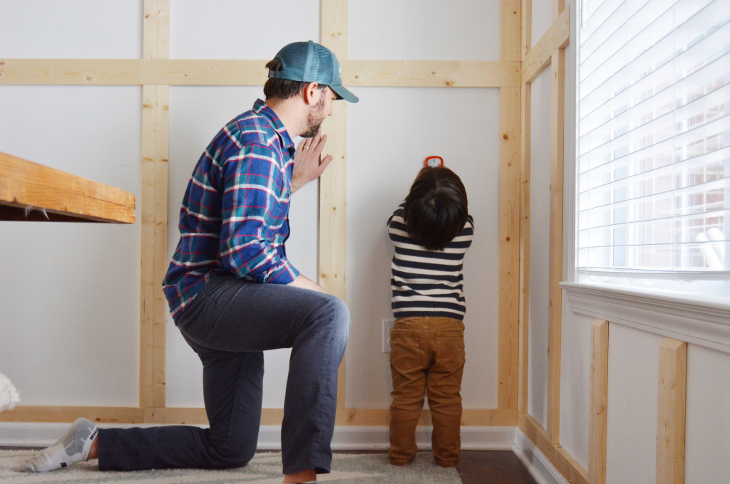 Man in plaid and little boy in stripes DIY