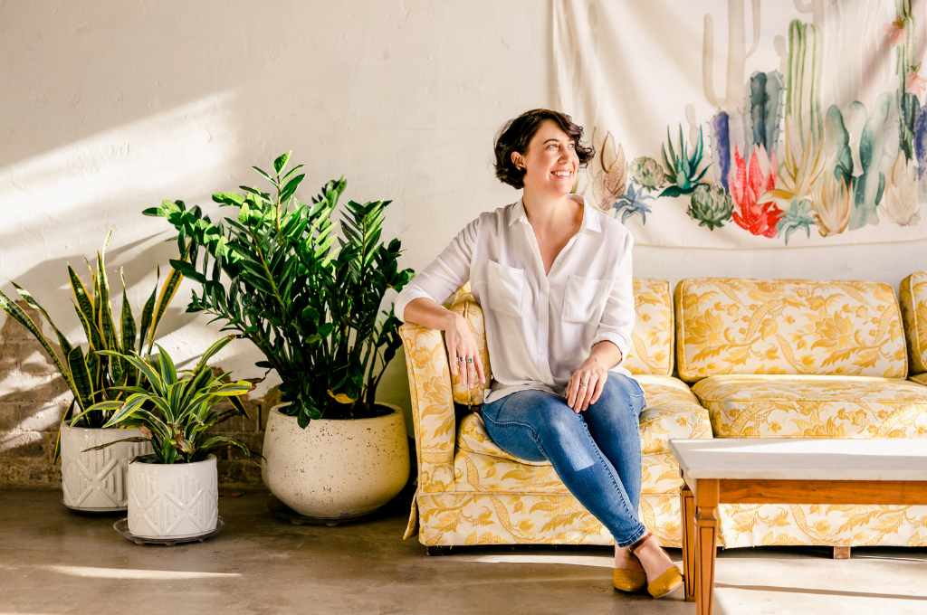 Mackenzie collier sitting on a sofa with plants