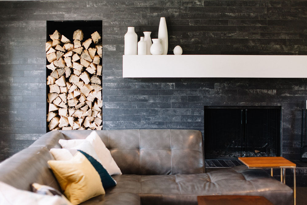 Living room with wood fireplace and sofa
