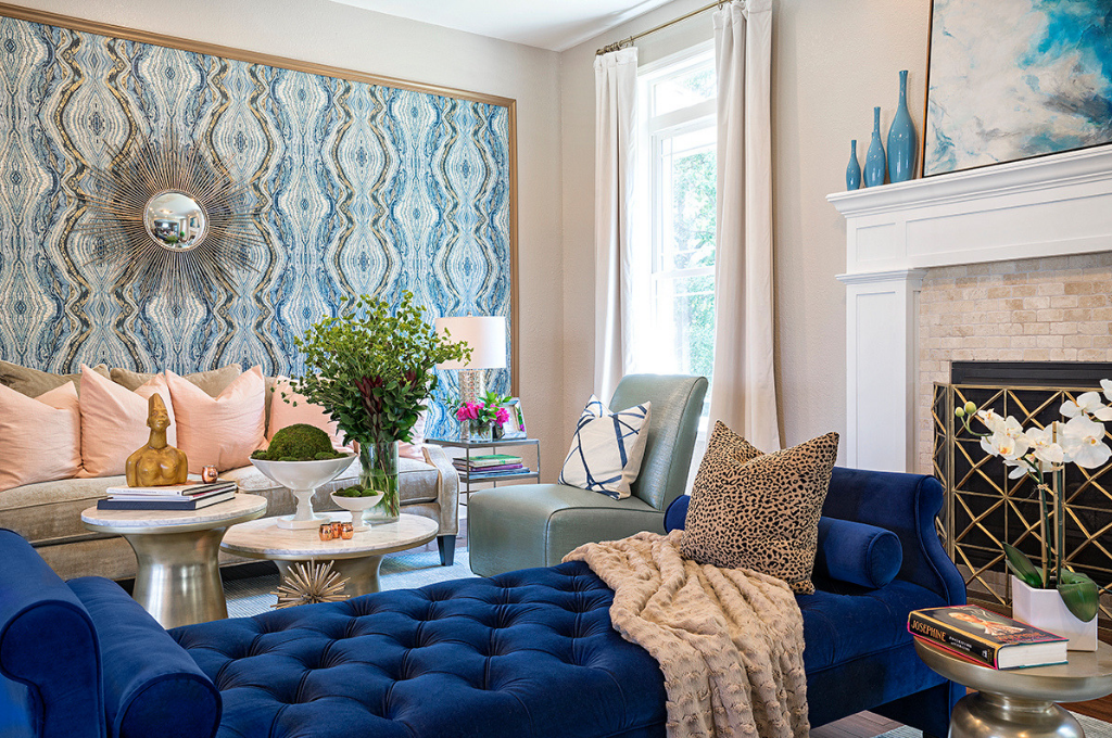 Living room designed by Tiffany Brooks Interiors with blue wallpaper and blue chaise lounge