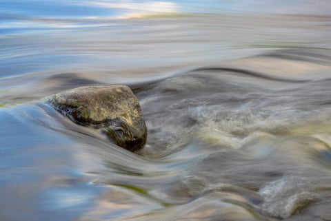 Flowing river over a rock