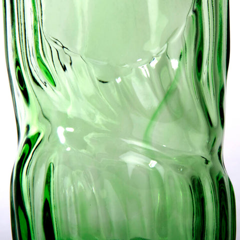 Close up of wonky glass River Rock whisky bottle