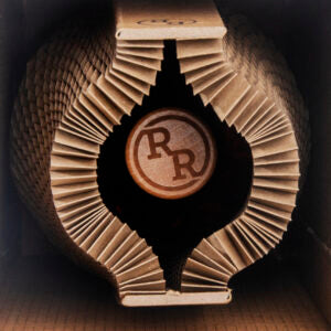 Bird's eye view of cardboard packaging with the bottle lid visible printed with River Rock logo