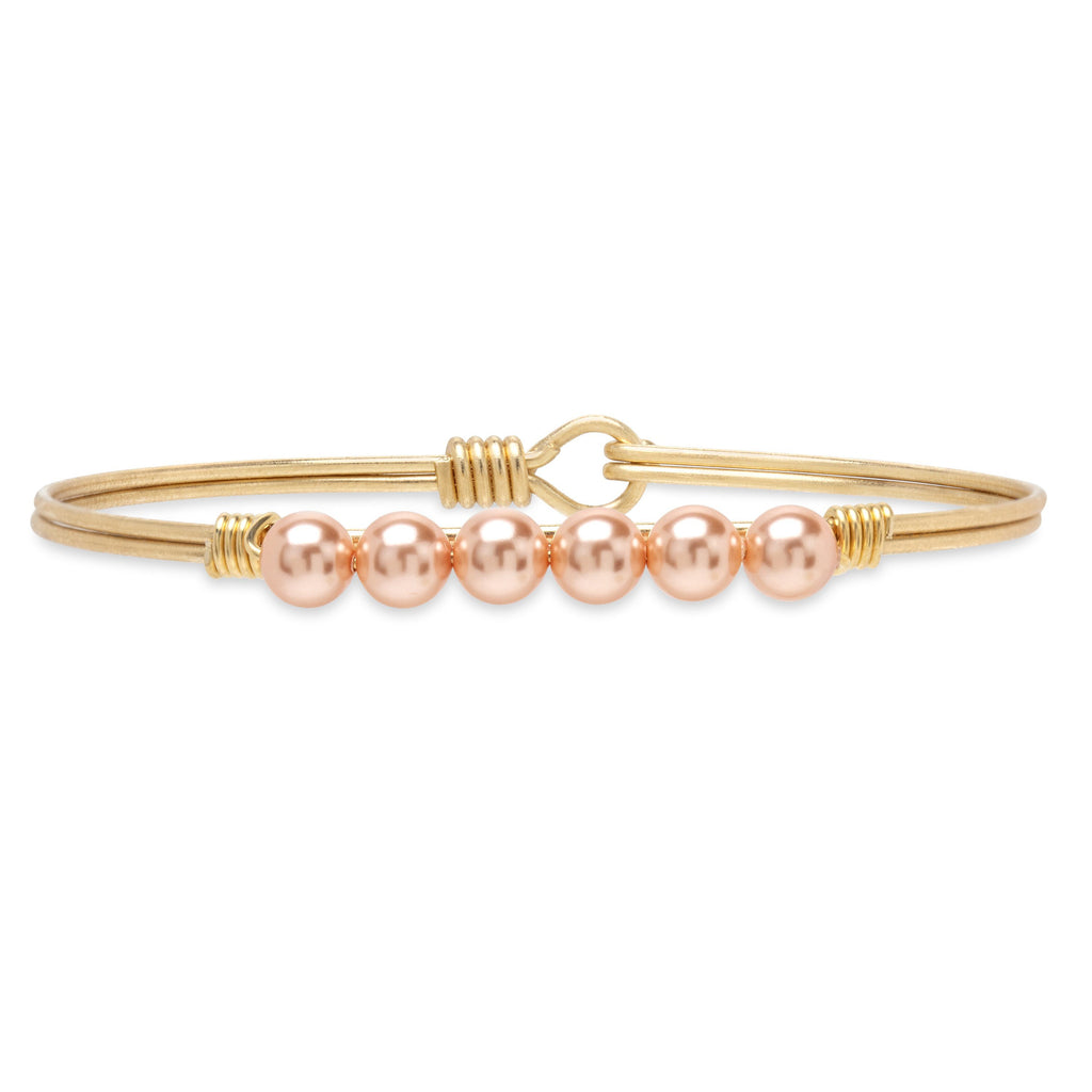 Crystal Pearl Bangle Bracelet in Peach finish:Brass Tone