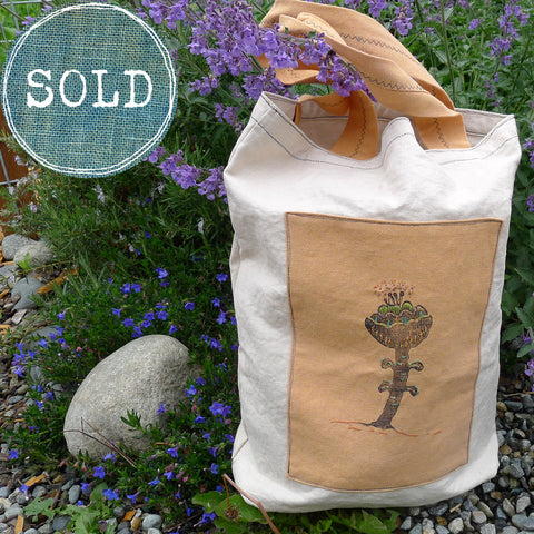 tea-dyed tote bag with orange botanical patch