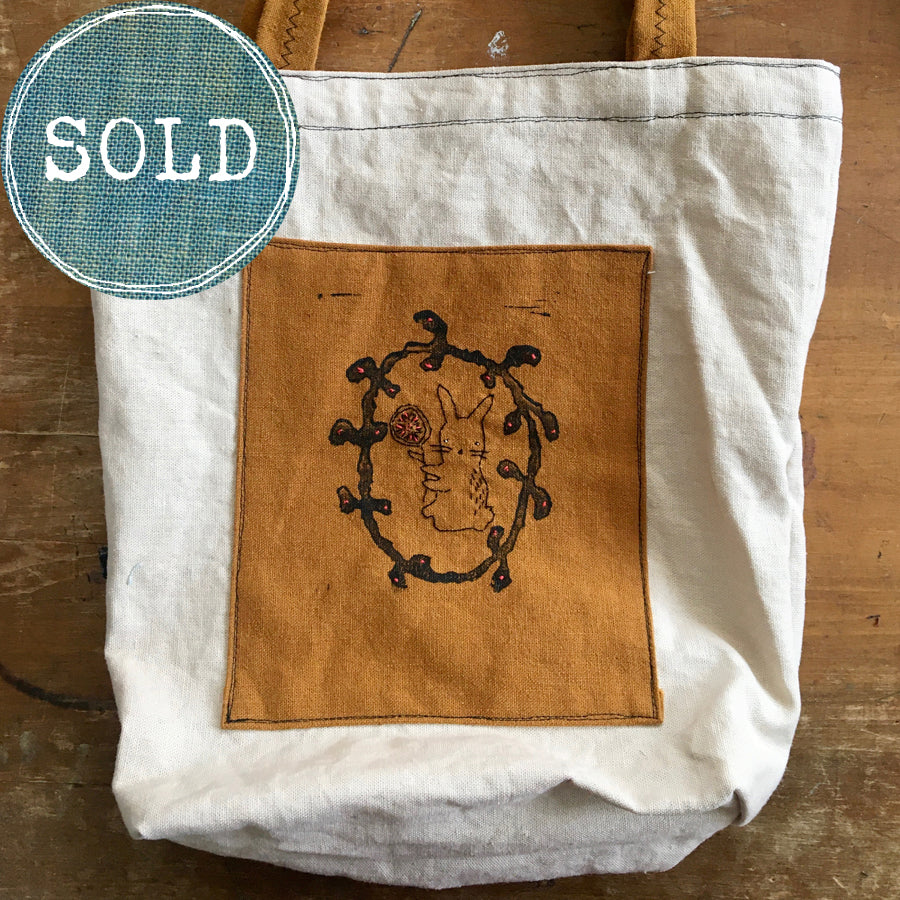 tea-dyed tote bag with ochre rabbit patch
