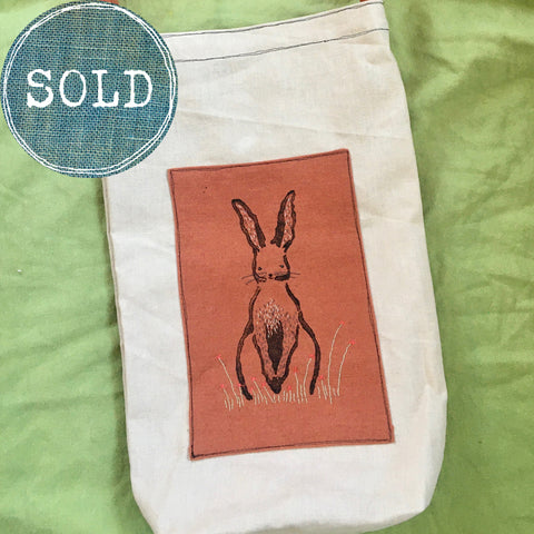 tea-dyed tote bag with terracotta rabbit patch