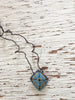 hand-stitched fabric amulet charm with adjustable clasp: blue