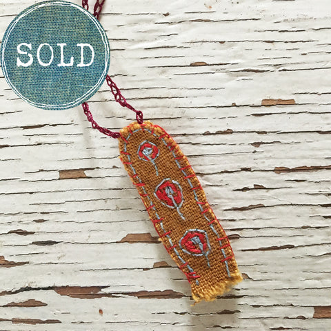 hand-stitched fabric amulet charm with adjustable clasp: ochre