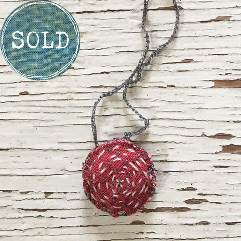 hand-stitched fabric amulet charm with adjustable clasp: red