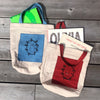 tea-dyed tote bag with blue owl patch