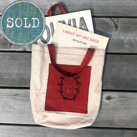 tea-dyed tote bag with red cat patch