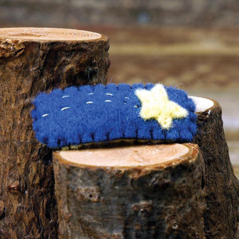 hair clip:  blue shooting star