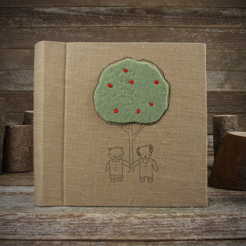 linen letterpress printed album with felt patch: cat and dog with apple tree