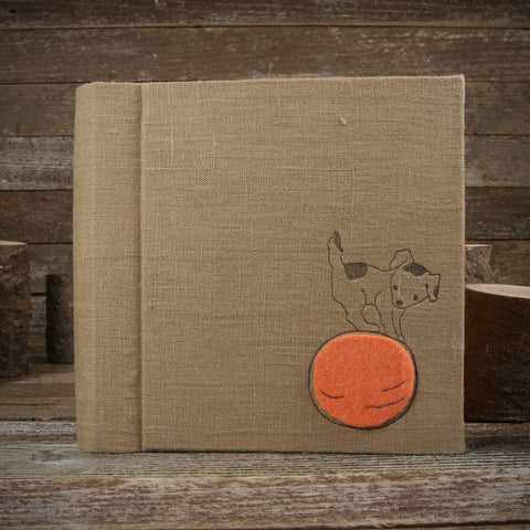 linen letterpress printed album with felt patch: dog on ball